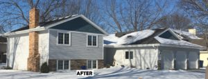 Great Barrier vinyl siding in Silver with Annapolis Blue shakes with white trim.